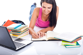 in the library - pretty, female student with laptop and books wo